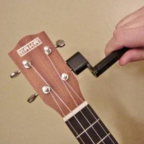 Manivela para encordar guitarra