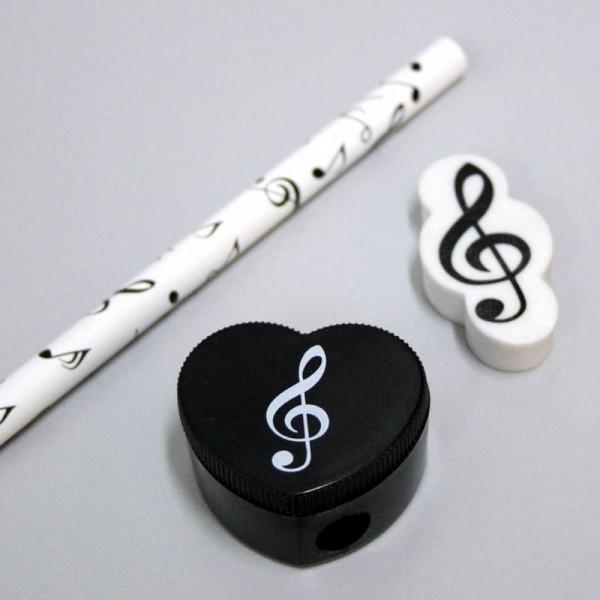 Pack con 1 lápiz, goma y sacapuntas. Decoración notas musicales