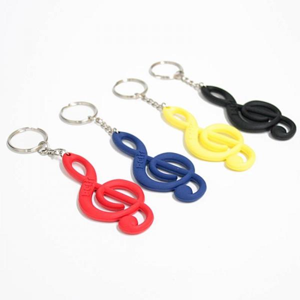 Llavero musical Clave de Sol fabricado en PVC, disponible en 4 colores: rojo, azul, amarillo y negro.