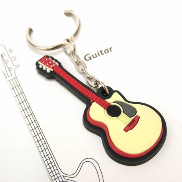 Llavero musical con forma de guitarra de PVC