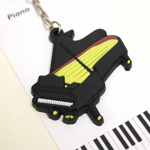 Llavero musical con forma de Piano. PVC.