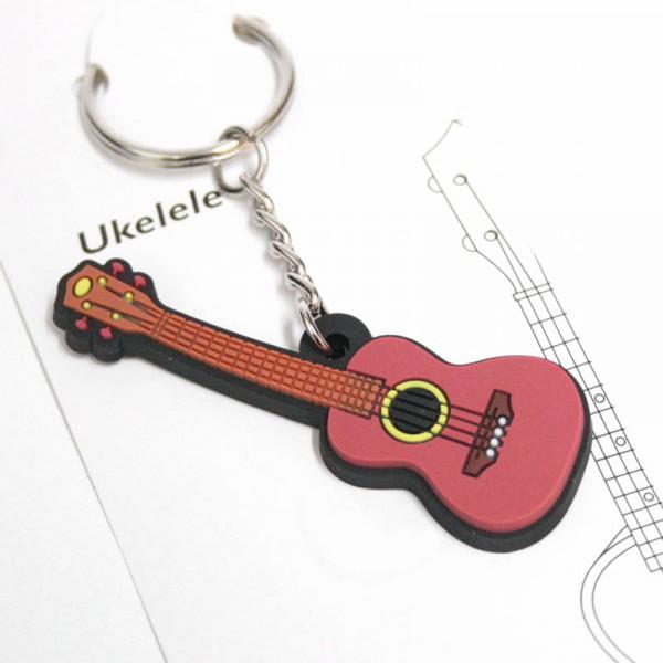 Llavero musical con forma de ukelele de PVC