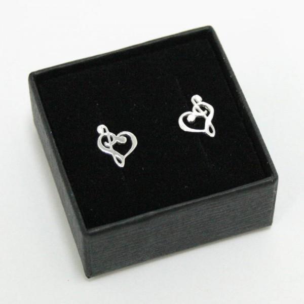 Mini Pendientes para músicos de plata de ley con forma de Clave de Sol y Clave de Fa. Cierre mariposa.