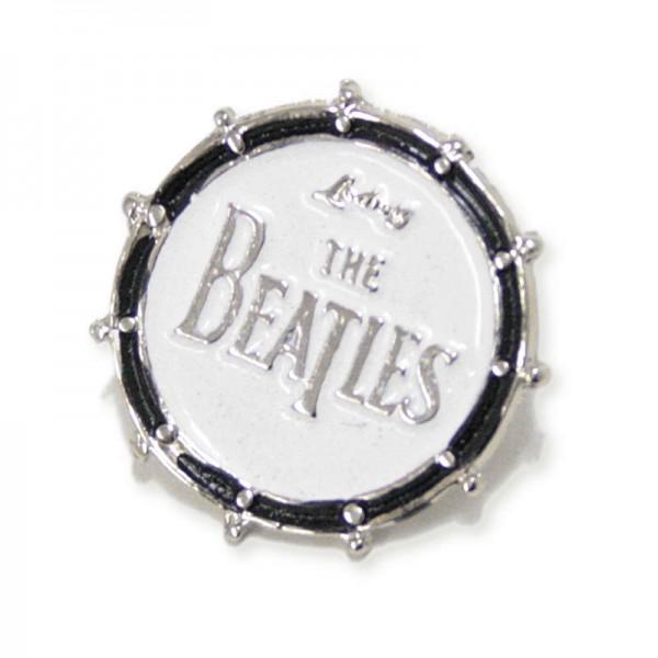 Pin metálico plateado con forma de bombo de los Beatles. Con 2 enganches mariposa.