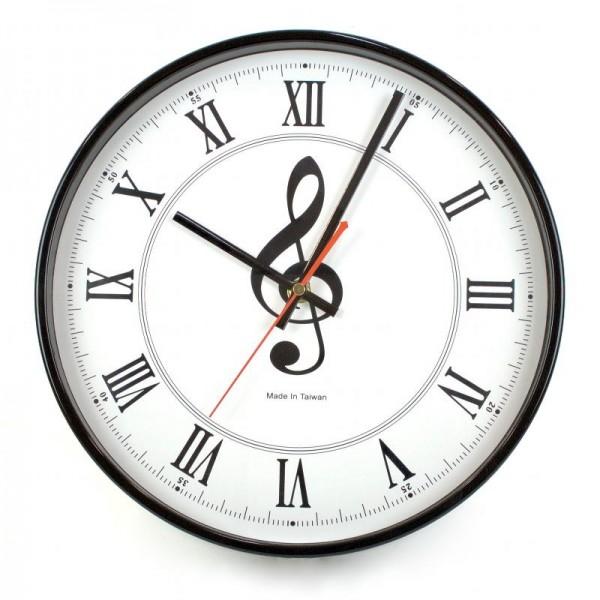 Reloj de pared con diseño musical de Clave de Sol. Mecanismo de cuarzo con segundero de movimiento continuo. 30 cm de diámetro.