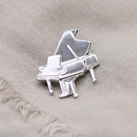 Piano brooch